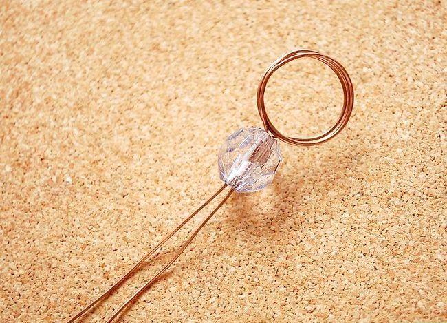 Imaginea intitulată Faceți un inel de șnur cu spirală înfășurat Pasul 4