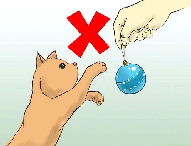 Protejați pomul de Crăciun de pisici