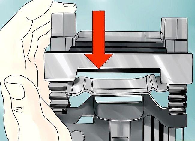 Imaginea intitulată Înlocuirea rotoarelor de frână Pasul 5